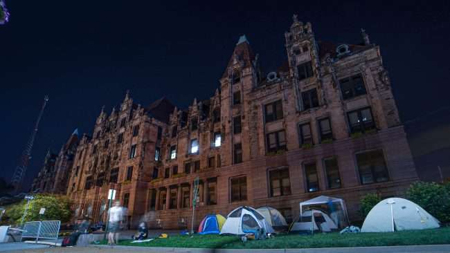 Occupy St. Louis City Hall: protesters in tents at night. credit craig currie