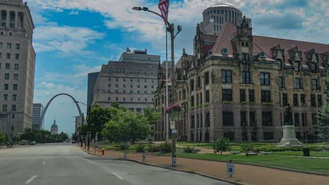 St. Louis City Hall with fence and yellow tape surrounding building due to protests. July 19, 2020 credit craig currie