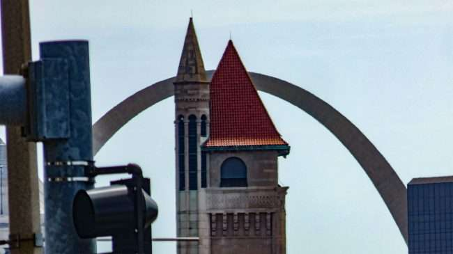 Union Station steeple with St. Louis Arch in background. credit craig currie July, 19, 2020