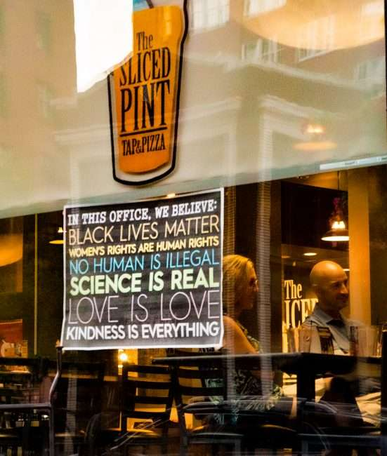Black Lives Matter sign in window at The Slice Pint restaurant on Washington Avenue in St. Louis. Aug 28, 2020