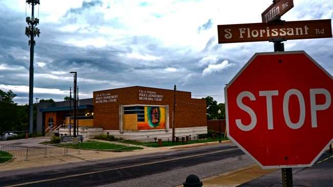 Ferguson Police Dept with mural painted on building. credit craig currie