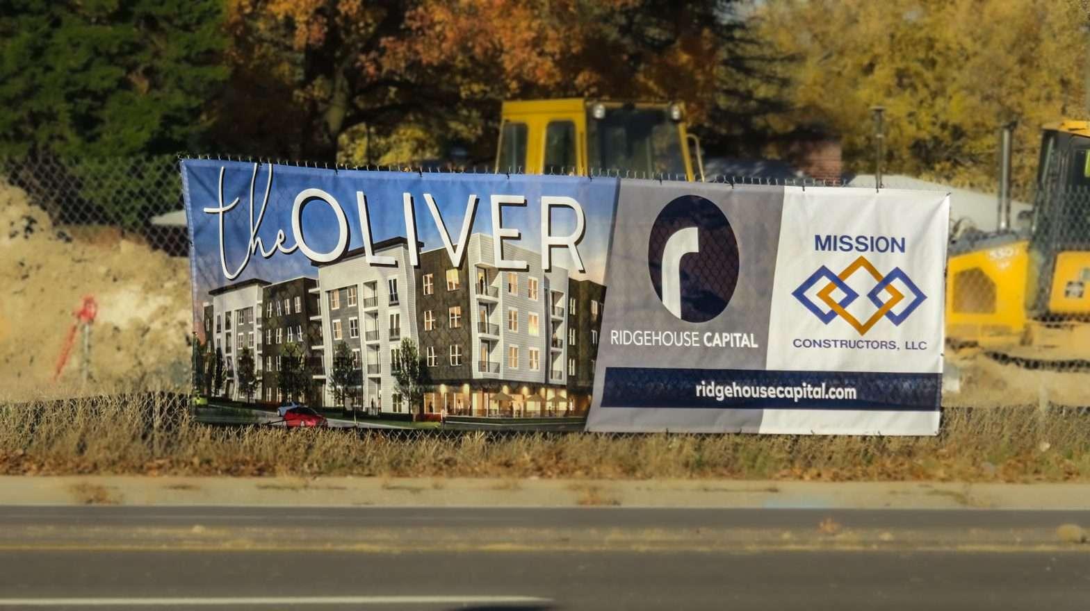 Banner THE OLIVER Apartments Olive Blvd, Creve Coeur. credit photonews247.com