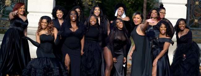 Black female entrepreneurs pose during The STL Collective Photoshoot 2020 (screen grab Craig Currie)