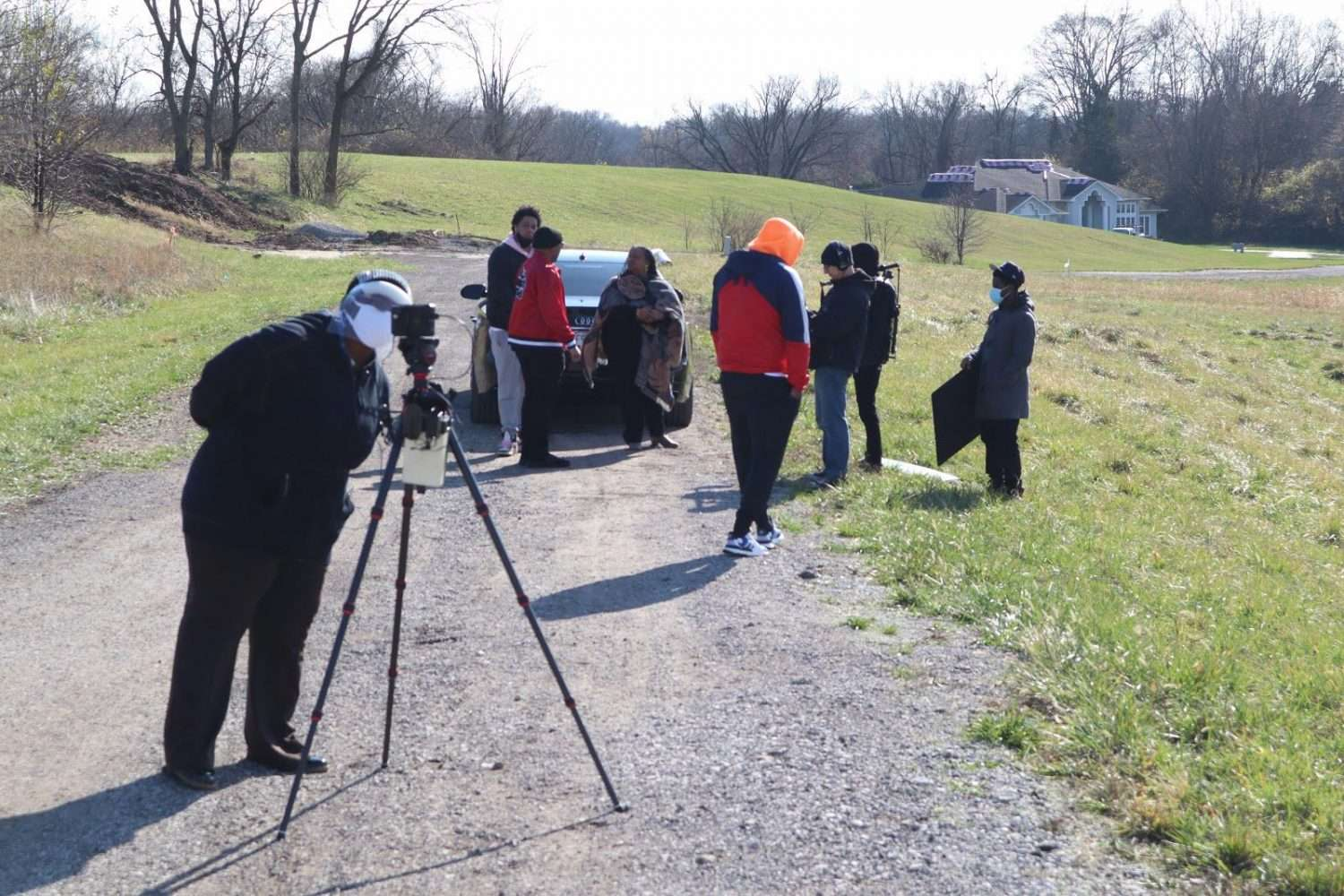 Monica R. Butler in her mask at the camera observes the previous shot taking place during the production on November 27, 2020 as Producer and Director Craig Thomas instructs the talent in the background. Photo credit: Purposed Productions