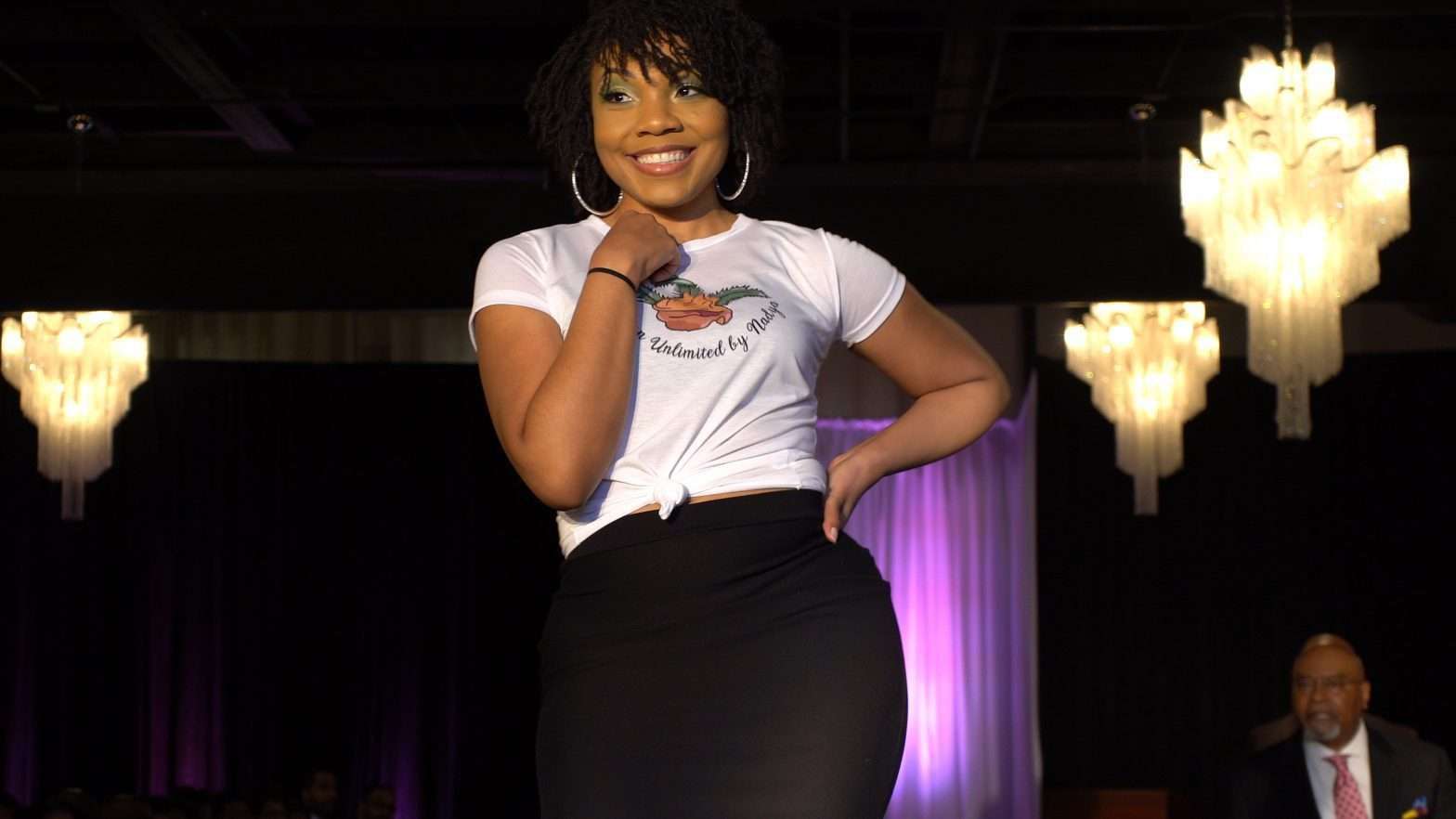 Coach Chi Anderson walks the runway to help raise funds to curb gun violence in St. Louis.