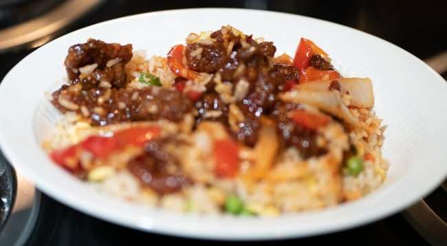 Beijing Beef and Fried Rice Bowl at Panda Express takeout. credit craig currie March, 2021.