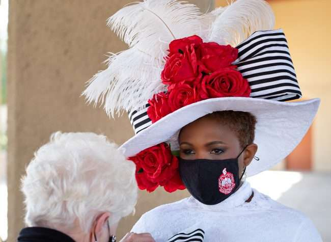 Wauneen Rucker, crowned Mrs. Missouri America 2021, getting finishing touches by Dianne Isbell at 1904 Pavilion at Forest Park Forever. Isbell is a St. Louis hat maker who created this hat inspired by the 1904 World's Fair. credit March 8, 2021 craig currie