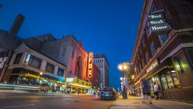 Fox Theatre St. Louis with marquee lights on in Grand Center.
