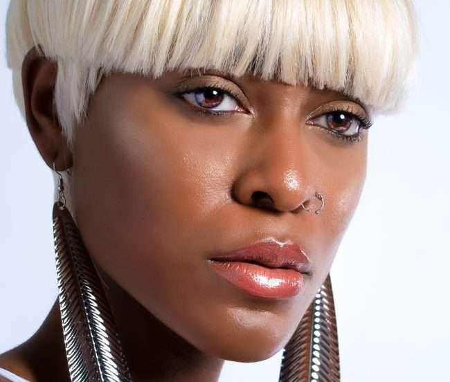 Bri Aaudrey T. models long silver earrings. credit craig currie