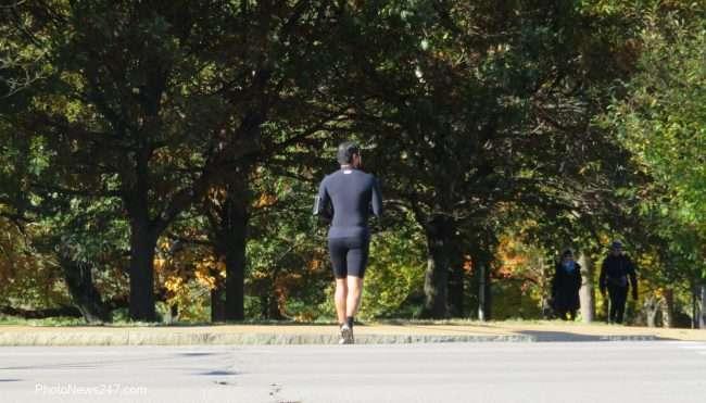 Gentleman jogging across Kingshighway towards Forest Park Forever. credit craig currie