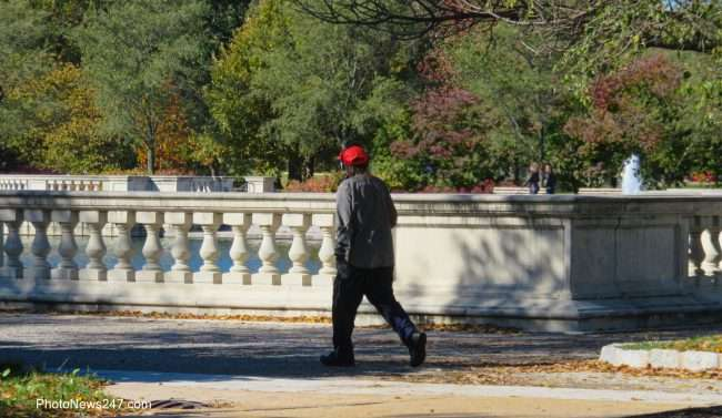 Gentleman walking with headphones on at Forever Forest Park. credit craig currie