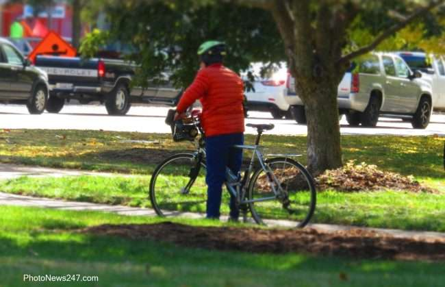Person riding a bike in Forest Park St Louis