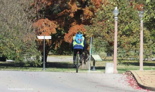 Person riding a bike in street in Forest Park Forever St Louis