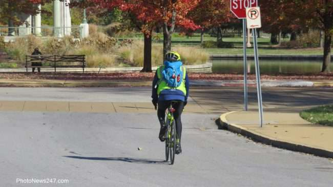 bike rider and jogger on path at Forest Park Forever. credit craig currie