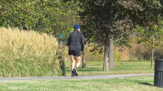 Jogger at World's Fair Pavilion Forest Park Forever