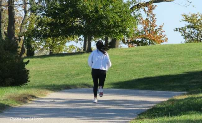 person jogging on path at Forest Park Forever