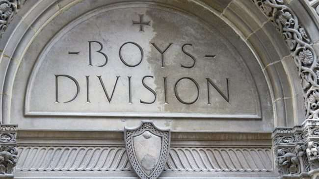 Boys Division at YMCA inscribed on building in Downtown St. Louis. May 2021 by craig currie