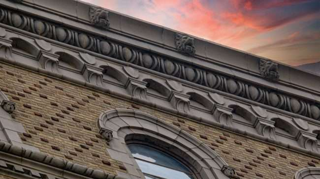 Lions heads at top of YMCA building Downtown St. Louis. May 2021 by craig currie