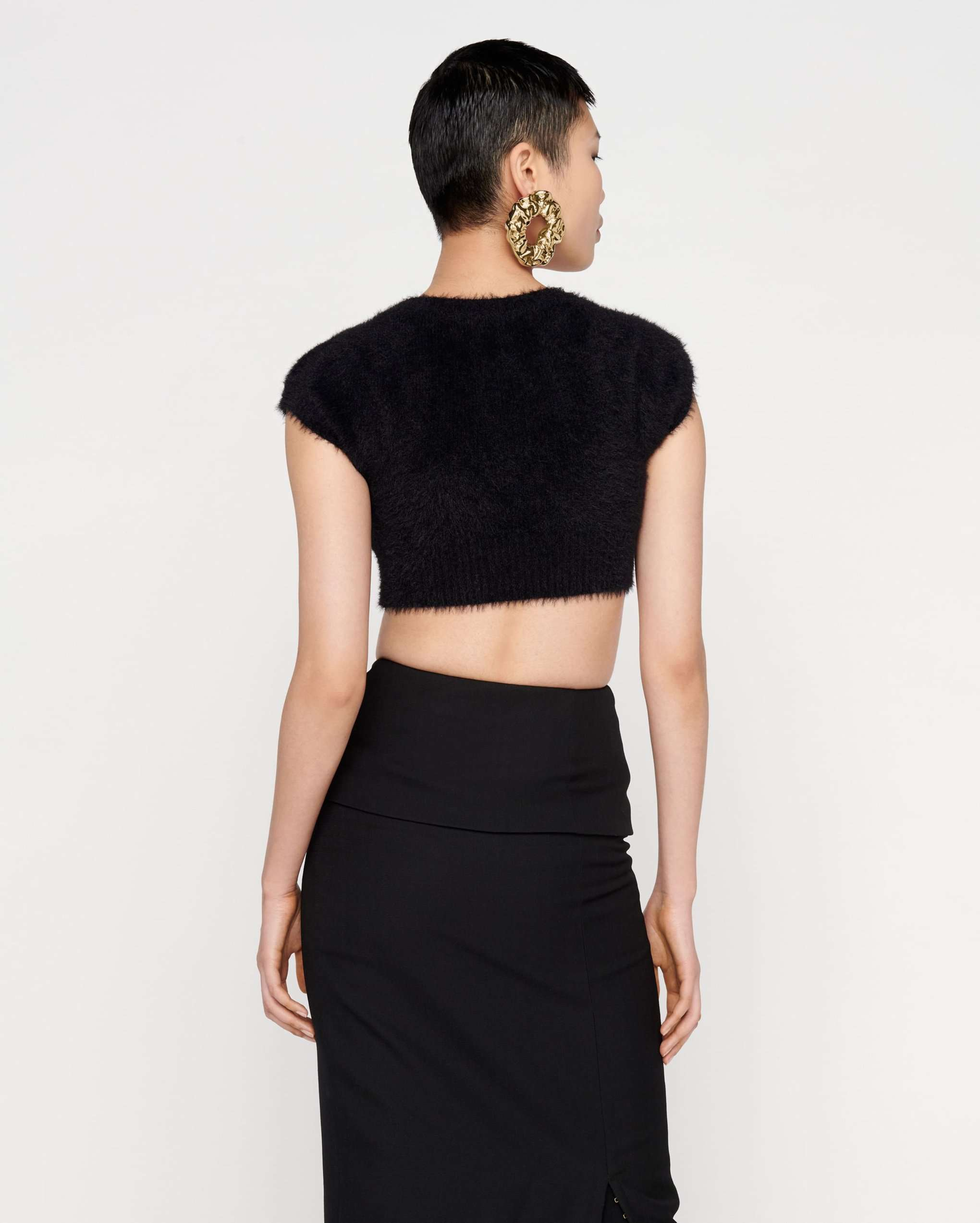 Cropped cardigan back view by Jacquemus. credit Jacquemus