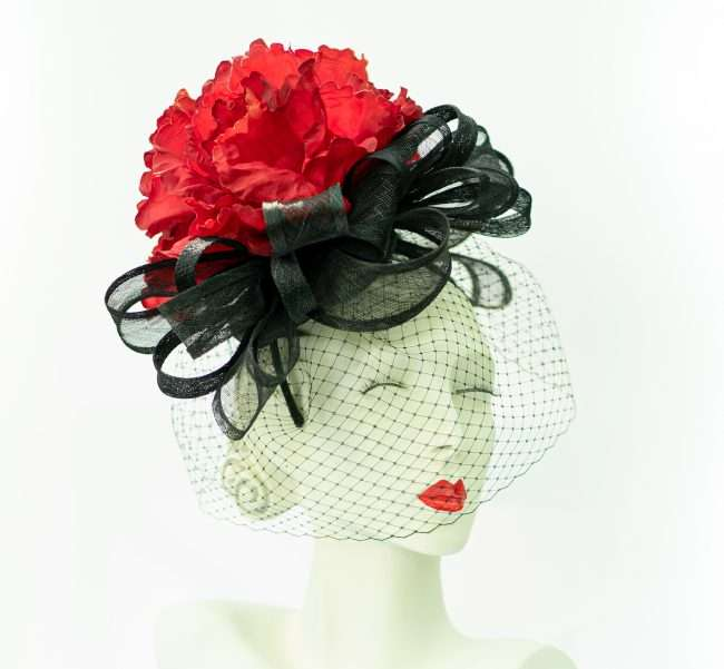 Red Flower Fascinator with veil from Hats by Dainne Isbell for Kentucky Derby and High Society Social Events. credit craig currie