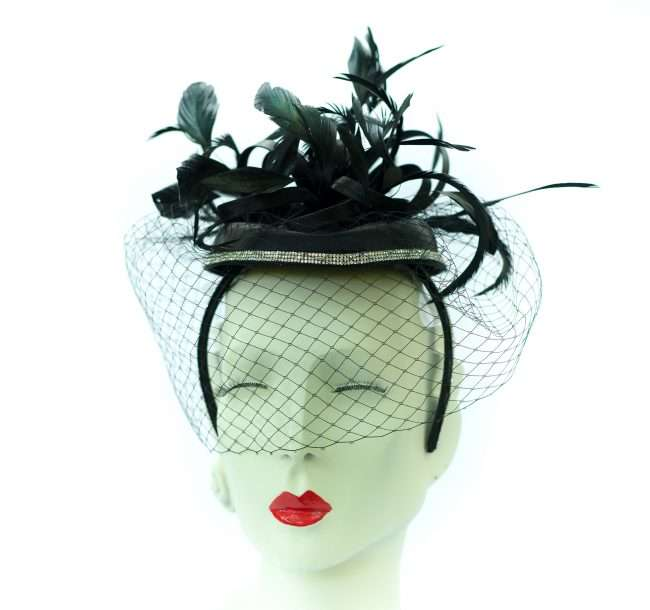 Kentucky Derby Fascinator with Dark Leaves and Black Vail by Hats by Dianne. credit craig currie