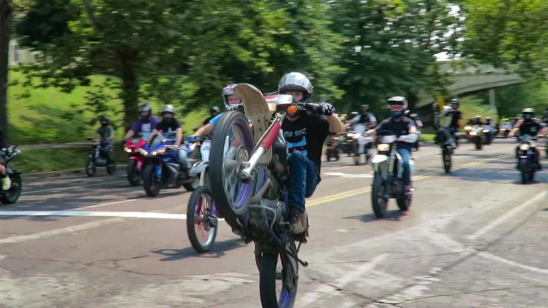 Ride of the Century 2021 - rider pops wheelie during ride. credit craig currie