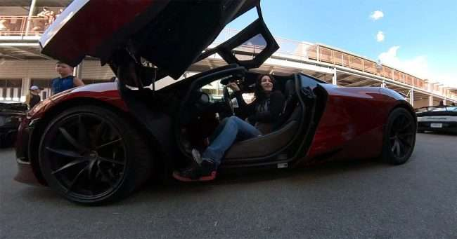 woman sits in car at St Louis Exotic Car Show City Foundry